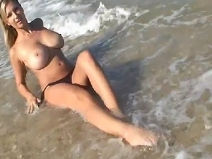 Busty Carol Goldnerova stripping naked and playing with her big juicy melons...