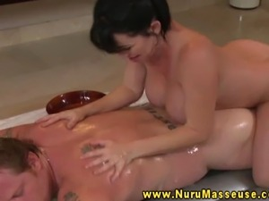 Busty asian massage beautie sensually rubbing down client in moist massage