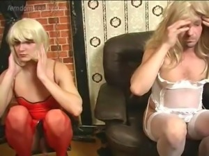 Mistress Crossdresses Two Slaves