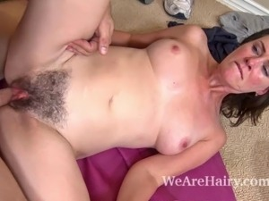 Hairy girl Veronica Snow is working out in her home gym when her trainer...
