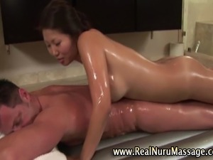 Sexy asian masseuse sucking horny fetish clients cock