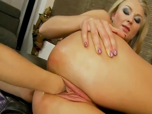 Lesbian blonde beauties love to fist fuck on the couch