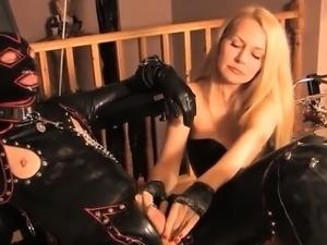 BDSM femdom masochism in latex with a blonde