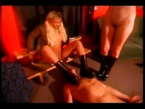 Two dominas in a hot trampling action