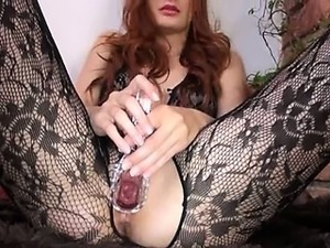 Gyno dildo in her huge redhead vagina