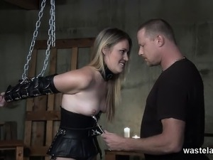 Blonde is chained and spanked by dominant master