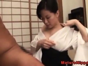 Japanese milf with huge tits sucks dick