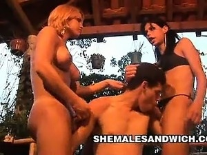 Sexy shemales Carla Renata and Yris Schimit share a boy