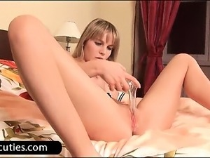 Teen minx playing with speculum