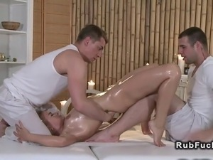 Two masseurs rubbing sexy tattooed body of blonde customer then giving her...