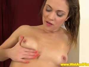 Pee fetish babe fingering her vulva after pissing everywhere
