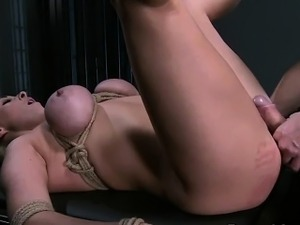 Tied up busty blonde slave gets fucked in bdsm