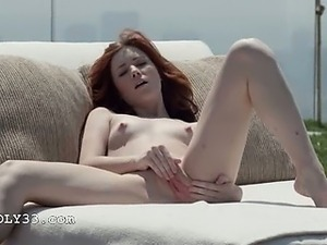 graceful redhead opening vagina outside