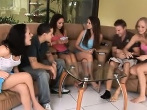 Four sexy teens playing strip poker with their male friends