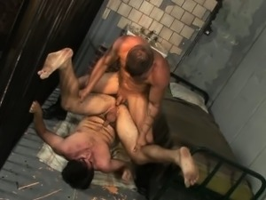 The guard slides his nightstick in a prisoner\'s open holes!