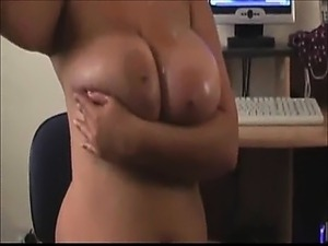 BBW oiling her big beautiful boobs