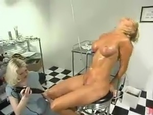 Thin Blonde female has Her coochie Toyed beside Electric sex toy