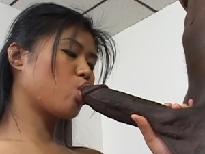 Asian babe takes a black dick