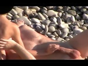 Voyeur on public beach. Handjob and Blowjob