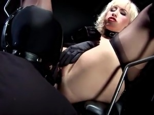 Busty Blonde Mistress playing with her Slave