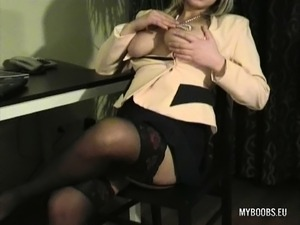 Naughty blonde secretary Malina puts her superb big hooters on display