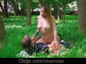 A beautiful teen was masturbating in the forest whilst an old pervert was...