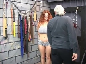 Redheaded slave gets bounded, blindfolded, and tortured in a sex basement