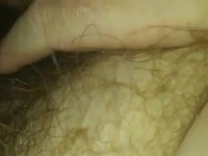 Louise fingering her hairy pussy