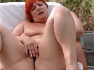 Curvy red-haired MILF