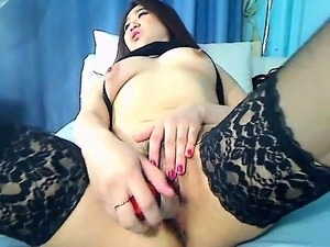 Busty Oriental nympho in stockings fucks her tight peach wi