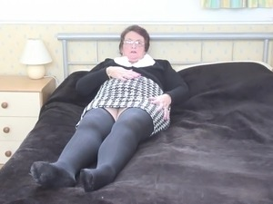 Granny in glasses and plays with her perky tits and cunt