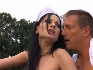 Gorgeous raven haired maid fucks with her boss by the car in the yard
