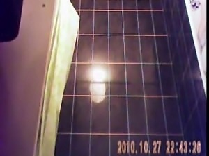 Hidden shower cam captures a hot chick getting completely n