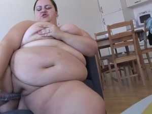 Gigantic belly on this solo BBW slut fucking a dildo
