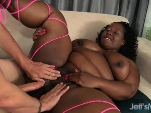 Big fat black bitch gets a white dick to nibble on and bang her cunt