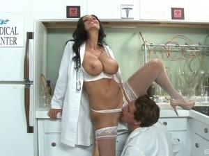 Busty brunette in nurse's uniform sucks a long pecker