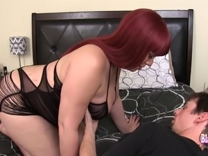 Redhead shemale happily allows her skinny friend to poke her hard