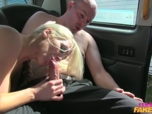 Big breasted blonde Rebecca is having sex with two men in a taxi