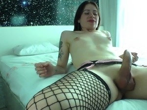 Shemale Nicole Bastiani jerking off her cock while dildo fucking her ass