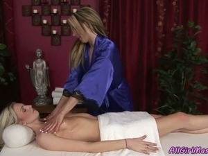 Blonde with perky tits goes lesbian with busty masseuse
