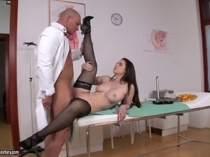 Doctor and a beauty in stockings and heels have sex