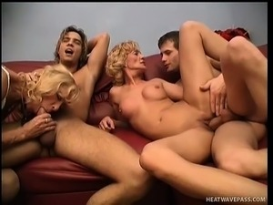 Two best buds share their Milf babes at a wild swinger's party