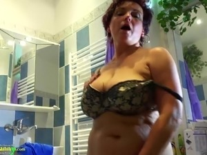 OldNannyBusty granny is doing striptease