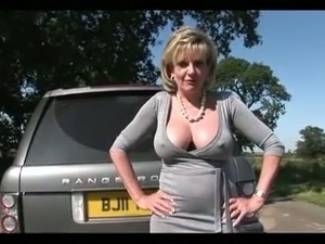 Rich mature whore with sexy curves is masturbating in her Ranger Rover