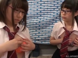 Japanese teens in glasses suck on his stiff dick together