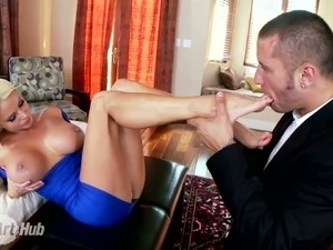 Blonde bombshell with big boobs  Nikita Von James gives a footjob