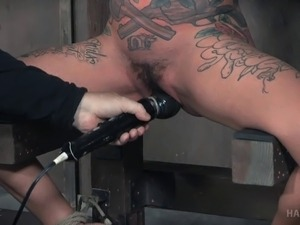 Tattooed dame tied widening legs then pleasured using toys in BDSM