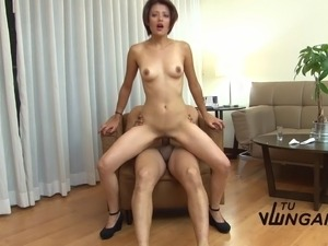 Shor-haired Asian is always energetic when riding a dick