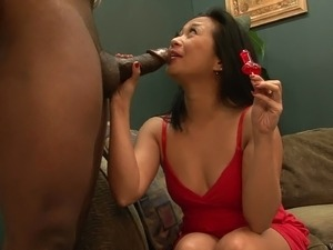 Asian cougar with petite tits licking and sucking a big black cock