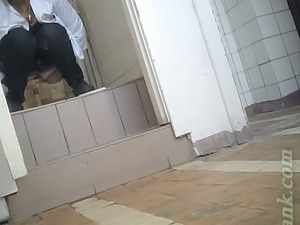 White lady in black pants and white blouse pissing in the toilet